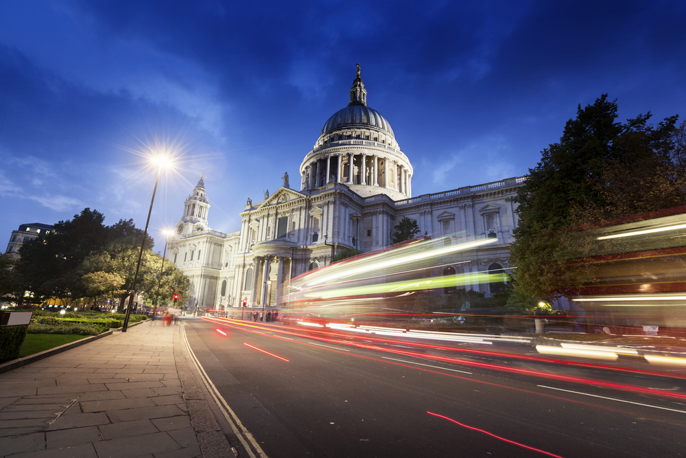 St Pauls Cathedral and moving Double Decker bus, London, UK